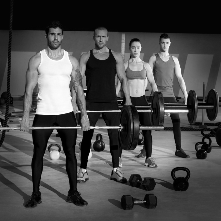 gym group with weight lifting bar workout in crossfit exercise